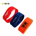 Bracelets NFC pour parc aquatique, centres de remise en forme - RFID wristband is the extension products of normal card, which is designed for easy carrying by person in swimming pool, construction place, pub, hospital, gsm center, etc. It combines the RFID and NFC technology with good looking and practical housings, completely water-proof. GYRFID present several types of wristbands to fit different customer''s demands. Material options: ABS/ PC/ Rubber/ Silicon/ Flexible Plastic / Paper/ PVC etc.